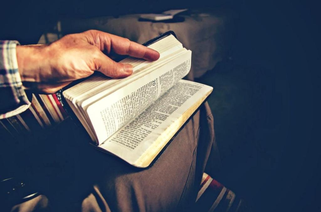 A man opens his Bible.