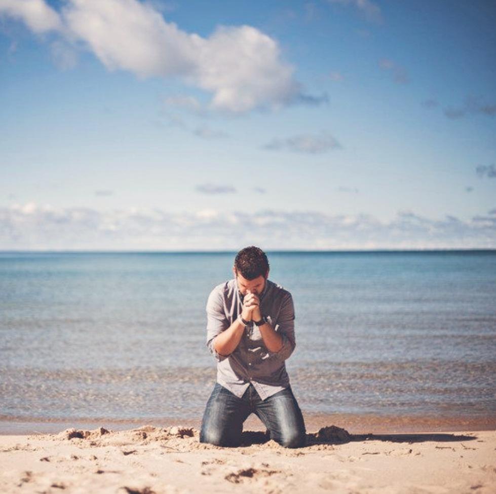 A man seeks God's forgiveness in prayer.
